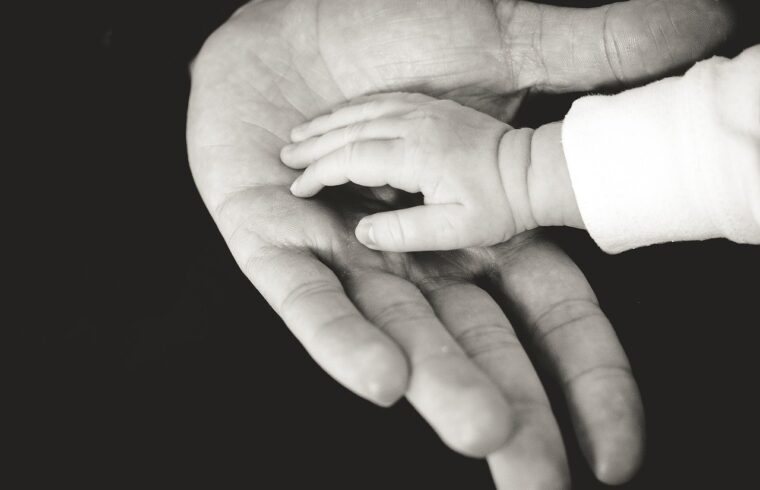 child and parents hand